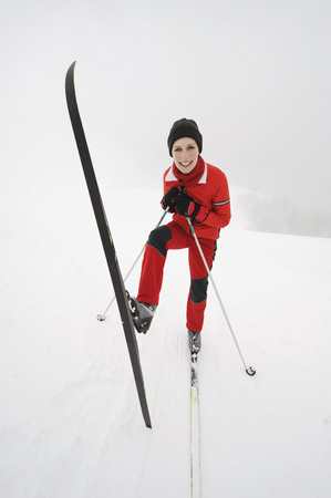 Italy, South Tyrol, Woman With Skis, Fooling About LANG_EVOIMAGES