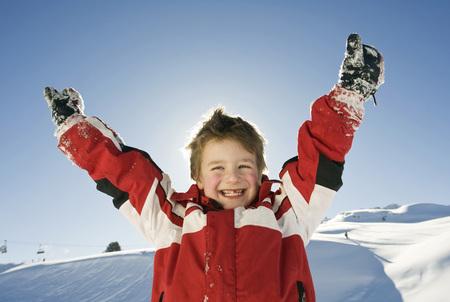 Italy, South Tyrol, Seiseralm, Boy (4-5) Cheering, Portrait, Close-Up