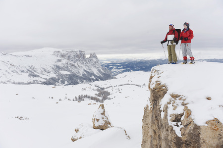 snowcovered: Italy, South Tyrol, Couple Witn Snowshoes Standing On Mountain Top