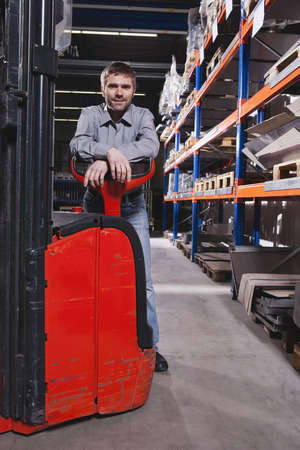 Germany, Neukirch, Foreman Leaning On Forklift Truck, Portrait LANG_EVOIMAGES