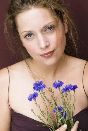 fiordaliso: Young Woman Holding Cornflowers, Portrait, Close Up