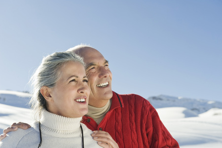 Italy, South Tyrol, Seiseralm, Senior Couple In Winterly Landscape, Portrait, Close-Up LANG_EVOIMAGES
