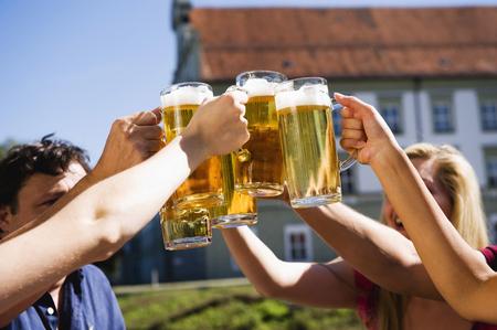 jarra de cerveza: Germany,Bavaria,Upper Bavaria,Cheerful People Toasting Each Other In Beer Garden