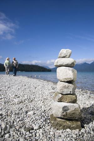 Germany,Bavaria,Walchensee,Senior Couple Taking A Walk,Stone Pyramid In Foreground