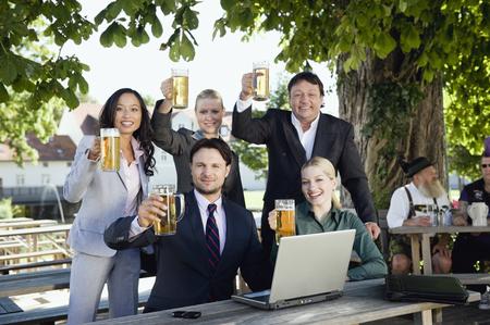 Germany,Bavaria,Upper Bavaria,Young Business People In Beer Garden,Portrait LANG_EVOIMAGES