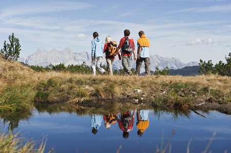 Austria,Salzburger Land,Four Hikers In Landscape,Rear View