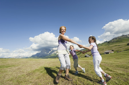 Italy,Seiseralm,Mother And Daughter (6-9) Playing In Meadow,Smiling