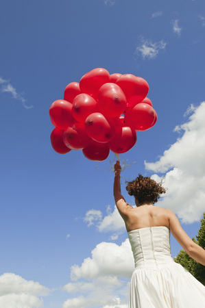 marrying: Germany,Bavaria,Bride Holding Red Balloons,Outdoors,Rear View