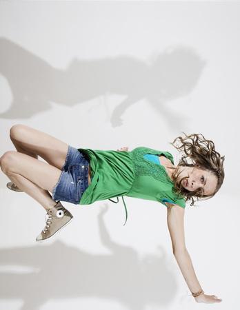 Germany,Berlin,Young Woman Breakdancing,Portrait