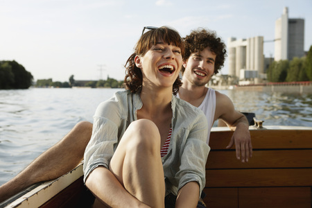 cheerfulness: Germany,Berlin,Young Couple On Motor Boat,Laughing,Portrait