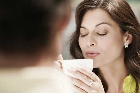 Italy,South Tyrol,Couple,Woman Holding Coffee Cup,Eyes Closed,Portrait