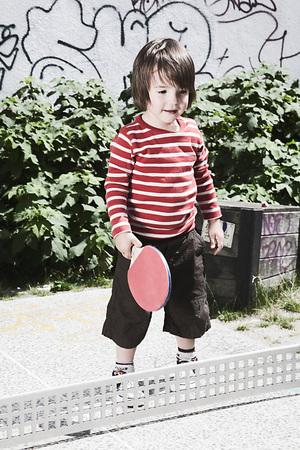 Germany,Berlin,Boy (2-3) Holding Table Tennis Bat