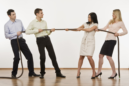 Businesspeople Playing Tug Of War LANG_EVOIMAGES
