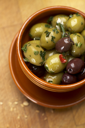Olives With Herbs In Bowl,Elevated View LANG_EVOIMAGES