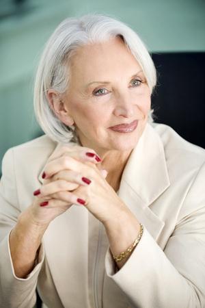 Germany, Munich, Senior Businesswoman, Folded Hands, Portrait LANG_EVOIMAGES
