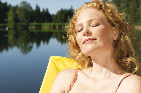 woman bath: Italy,South Tyrol,Woman Sunbathing On Jetty By Lake