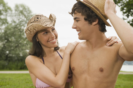 Germany,Bavaria,Starnberger See,Young Couple Outdoors Wearing Hats,Close-Up