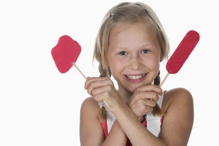 Girl (10-11) Holding Lollypops,Smiling,Portrait LANG_EVOIMAGES