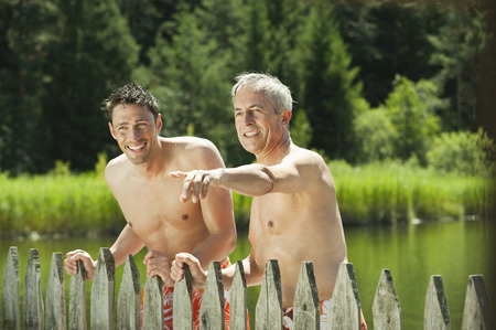 nackte brust: Italy,South Tyrol,Men Standing By Wooden Fence,Portrait LANG_EVOIMAGES
