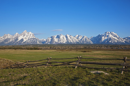 Usa,Wyoming,Wooden Fence In Foreground,In Background Teton Range Mountains