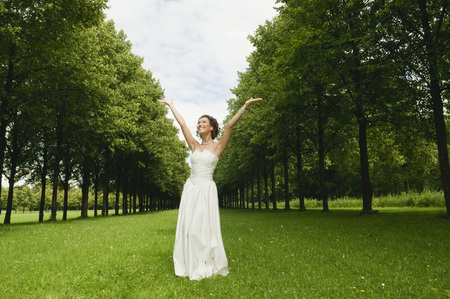 marrying: Germany,Bavaria,Bride In Park Cheering,Portrait