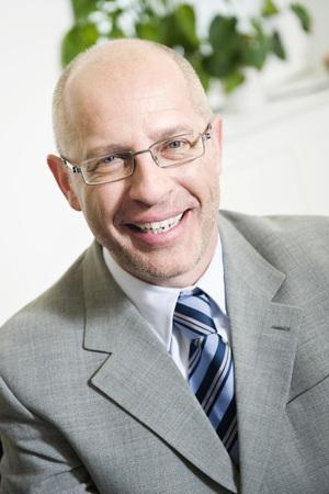 one mature man only: Germany, Munich, Businessman Smiling, Portrait