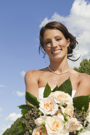 Germany,Bavaria,Bride Holding Bunch Of Flowers,Portrait,Close-Up