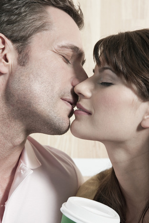 Germany, Cologne, Couple Kissing, Eyes Closed, Portrait, Close-Up LANG_EVOIMAGES