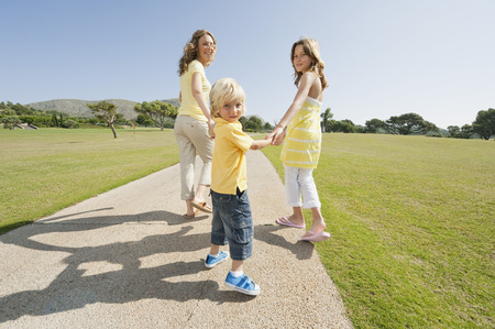 Spain,Mallorca,Mother And Children (4-5),(10-11) Having A Walk LANG_EVOIMAGES