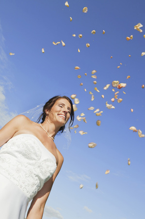 marrying: Germany,Bavaria,Bride Smiling Under Falling Petals,Portrait,Low Angle View