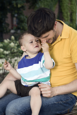 Germany,Berlin,Son (18-23 Months) Holding FatherS Nose