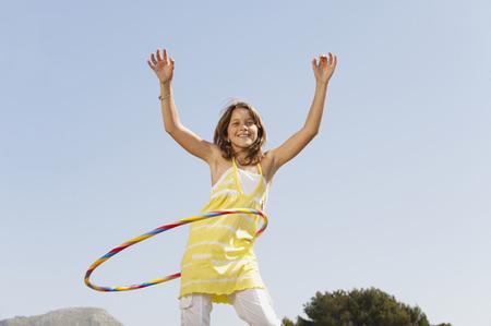 mallorca: Spain,Mallorca,Girl (10-11) Playing With Hula Hoop