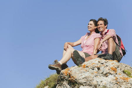 Italy,South Tyrol,Hiker Couple Sitting On Rock LANG_EVOIMAGES