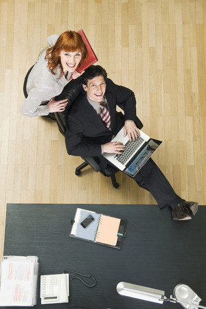 Germany, Munich, Business People In Office, Using Laptop, Elevated View