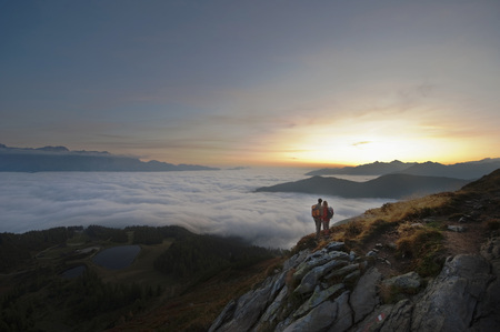 Austria,Steiermark,Reiteralm,Hikers Admiring View Over Clouds LANG_EVOIMAGES