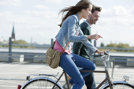 Germany,Berlin,Young Couple With Bicycle LANG_EVOIMAGES