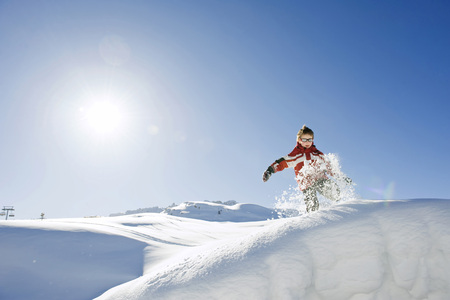 Italy, South Tyrol, Seiseralm, Boy (4-5) Playing In Snow