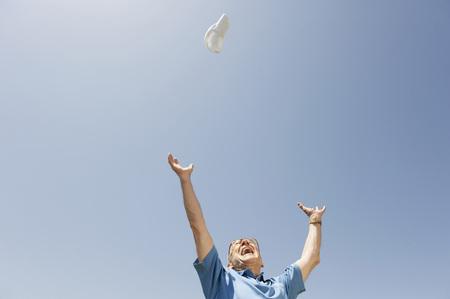 sandalias: Senior Man Throwing Shoe In The Air,Cheering,Portrait LANG_EVOIMAGES