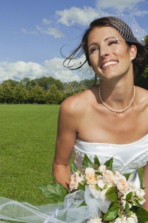 marrying: Germany,Bavaria,Bride In Park Holding Bunch Of Flowers,Portrait,Close-Up