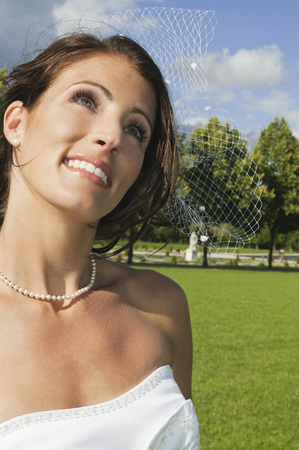 marrying: Germany,Bavaria,Bride In Park Looking Up,Smiling,Portrait,Close-Up