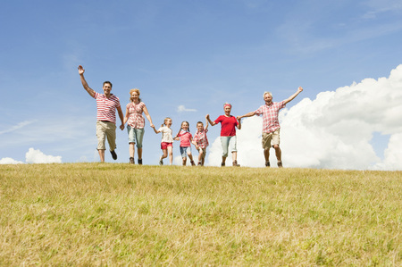Italy,Seiseralm,Family Walking In Field,Cheering