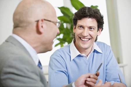 Germany, Munich, Business People Talking, Portrait LANG_EVOIMAGES