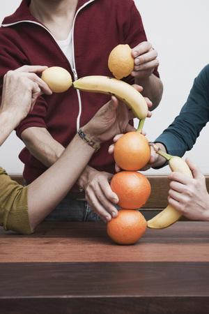 help section: Men And Women Balancing Fruits