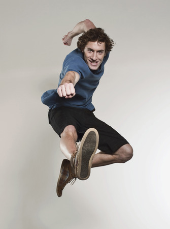 punched out: Man Jumping And Punching In Air,Smiling,Portrait