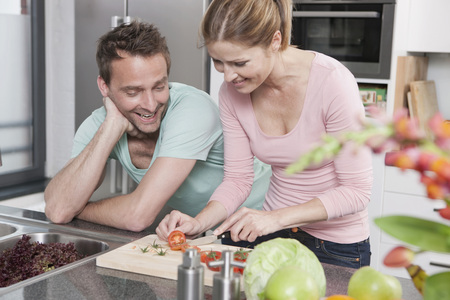 Germany,Couple Preparing Salad In Kitchen,Smiling