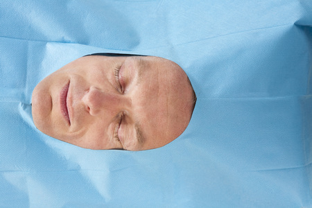 Germany,Munich,Overhead View Of Patient With Eyes Closed