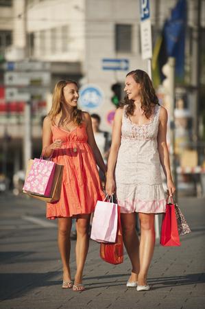 Germany,Munich,Karlsplatz,Young Women Enjoying Shopping LANG_EVOIMAGES