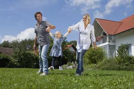 Germany,Munich,Family Having Fun In Front Of House LANG_EVOIMAGES