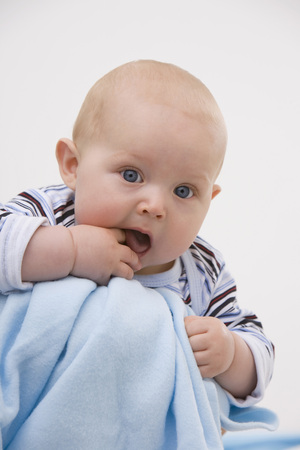 Baby Boy (6-11 Months) With Finger In Mouth,Portrait