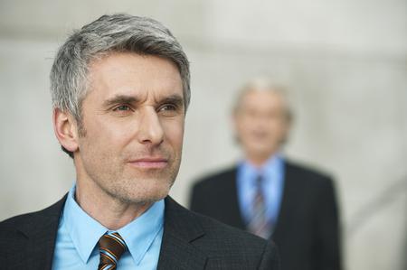 Germany,Hamburg,Businessmen,Mature Man Looking Away In Foreground